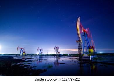 Oil pump at night, oil beam pumping unit at night