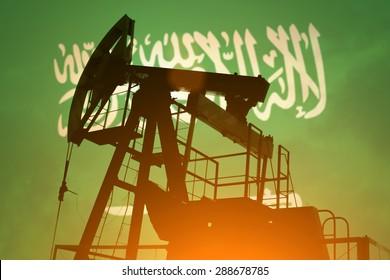 Oil pump on background of flag of Saudi Arabia
