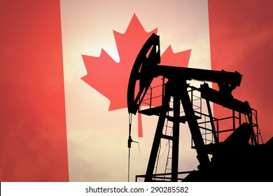 Oil pump on background of flag of Canada