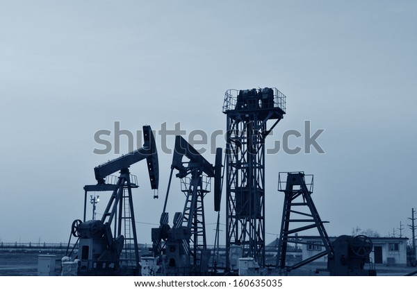 Oil pump in the orange sunset, taken in the luanhe river south excrementum bombycis mouth, in the north of China