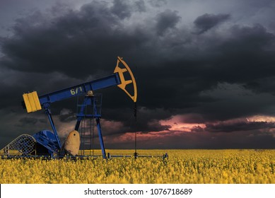 Oil pump oil rig energy industrial machine for petroleum in the rape rope and cloudy sky
