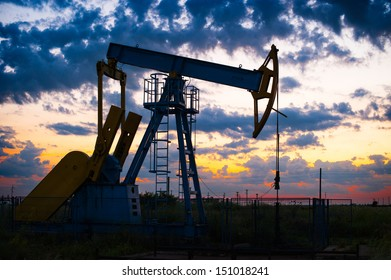 Oil pump oil rig energy industrial machine for petroleum in the sunset/sunrise background for design