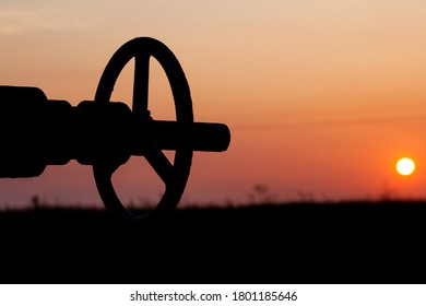 Oil pump valve at sunset