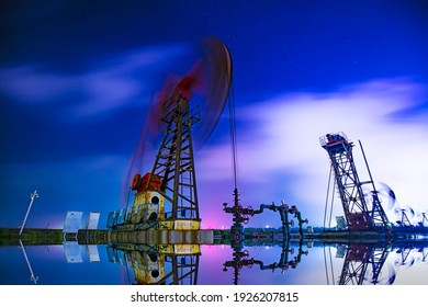 Oil pumping machinery in operation, crude oil extraction scene in the night, North China