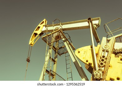 Oil pumpjack, industrial equipment. Rocking machines for power genertion. Extraction of oil. Petroleum concept.