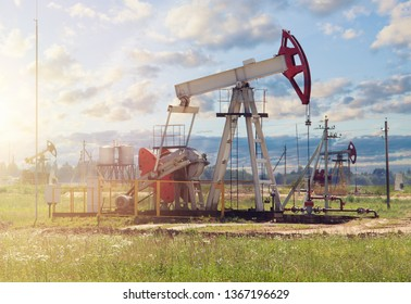 Oil pumpjack on sky clouds background.  Oil well industry