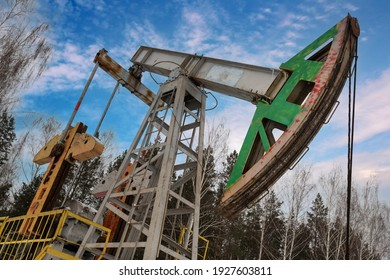 Oil pumpjack winter work is the overground drive for a reciprocating piston pump in an oil well. It is used to mechanically lift liquid out of the well. Oil pumpjack.