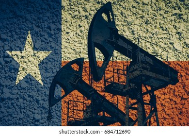 Oil pumps against a Texas flag background