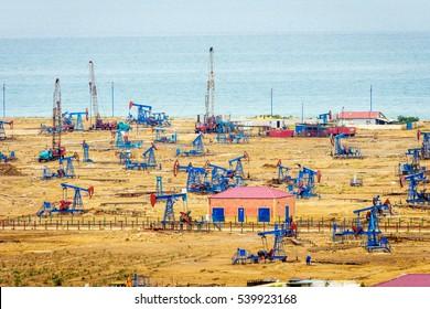 Oil pumps and rigs at the field by Caspian sea near Baku, Azerbaijan