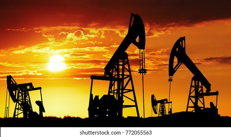 Oil pumps silhouette at colorful sunset