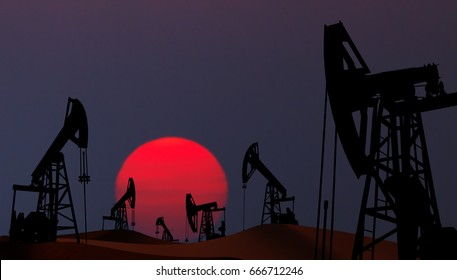 Oil pumps silhouette at  sunset