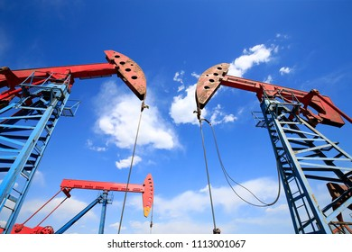 Oil pumps are working in the blue sky background