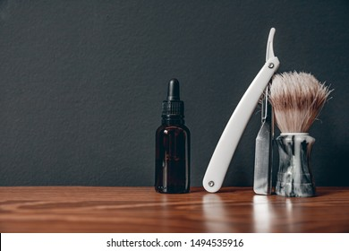Oil with razor for care and growth of beard, barbershop.