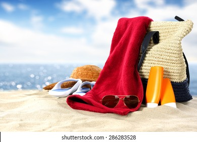 oil red towel glasses and sand