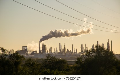 Oil refineries polluting carbon and cancer causing smoke stacks climate change and power plants in Corpus Christi , Texas a massive large refinery - Shutterstock ID 766204174