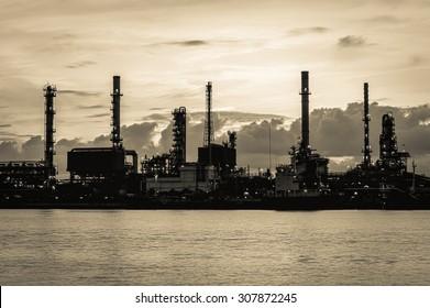 Oil refinery along the river (Bangkok, Thailand).Vintage tone