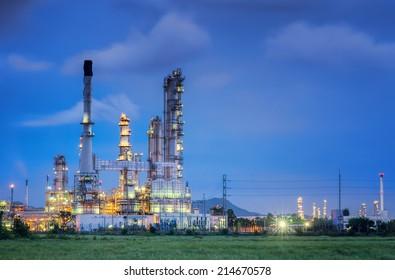 Oil refinery along twilight sky