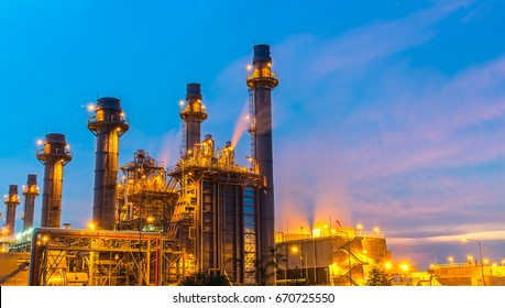Oil refinery building plant and construction site at twilight with blue sky background