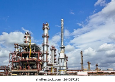 Oil refinery building under cloudy sky