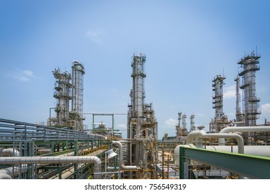 Oil refinery and chemical industrial plant ,Process area structure and vertical refinery column with blue sky ,image for business industrial , safety and energy concept