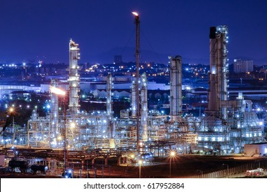 Oil refinery or chemical plant at Blue night sky