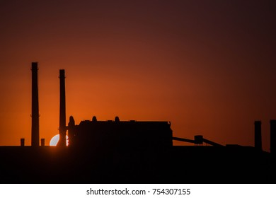 Oil Refinery Chemical Plant Metallurgical Silhouette at Sunset
