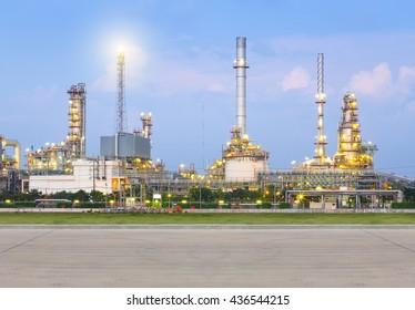 Oil refinery and concrete pavement at twilight.