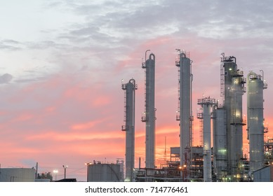 Oil refinery at dramatic sunrise. Oil factory, petrochemical plant in Corpus Christi, Texas, USA. Petroleum industry background.