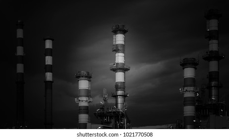 Oil refinery at dusk. Converted black and white.