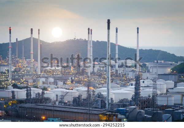 Oil Refinery factory at the evening , petrochemical plant , Petroleum