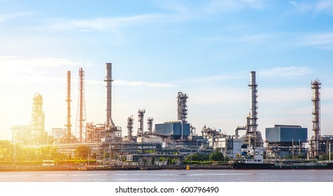 Oil refinery factory and logistic over sunrise Bangkok Thailand,with silhouette,,The equipment of oil refining,industrial pipelines of an oil-refinery plant, refinery power energy system station.