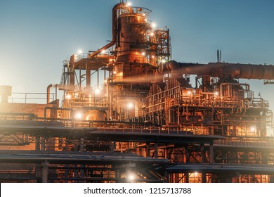 Oil refinery factory in night, steel towers, vats  and pipeline, modern production of energy and petroleum concept, toned