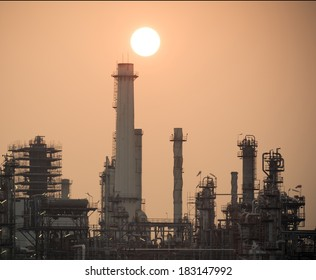 Oil refinery factory over sunrise Bangkok Thailand