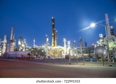 Oil refinery, oil factory, petrochemical plant at blue hour in Corpus Christi, Texas, USA.