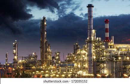 Oil refinery factory silhouette over sunrise