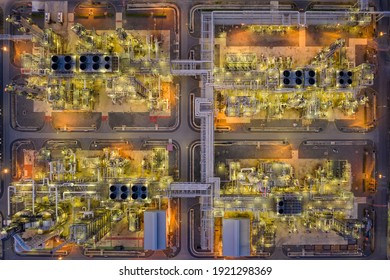 oil refinery and gas petrochemical industry with storage tanks steel pipeline area at twilight aerial view from drone in Thailand