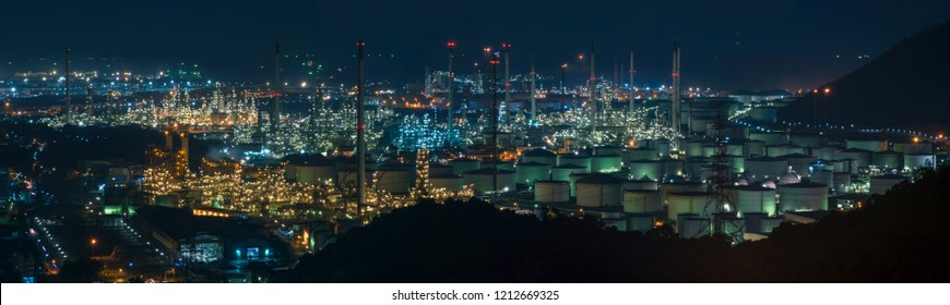 Oil refinery industrial plant at night panorama