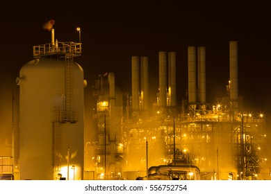 Oil refinery industrial plant at night, Thailand