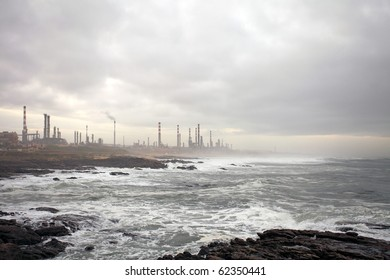 Oil refinery near the sea in a cloudy early morning