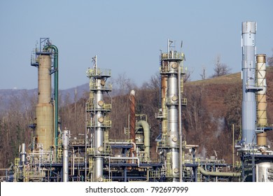 oil refinery on blue sky cloudy background