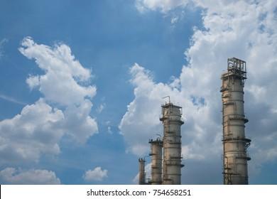 Oil refinery on sky background.