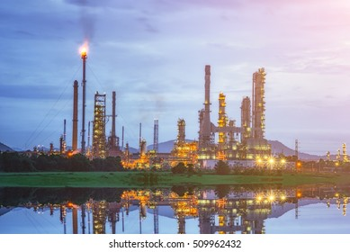 Oil refinery petrochemical industry plant at sunrise.