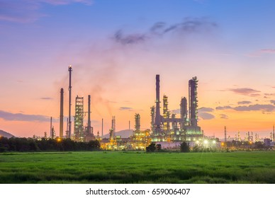 Oil refinery in petrochemical industry with sunset time