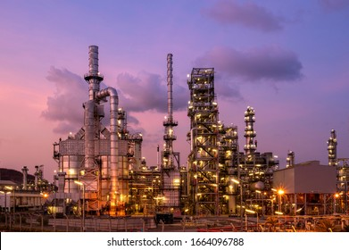 Oil refinery and petrochemical plants, natural gas storage tanks and steel pipe equipment with a blue night sky background