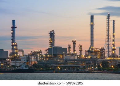 Oil refinery plant industry at dramatic twilight