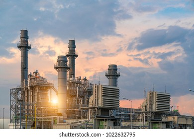 Oil refinery plant industry at sunrise with