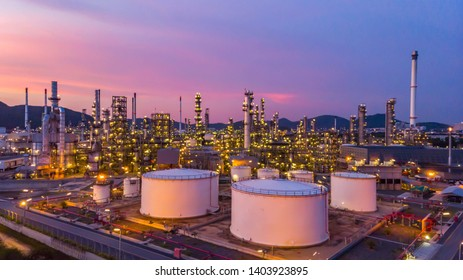 Oil refinery plant from industry zone. Refinery factory oil on sunset.