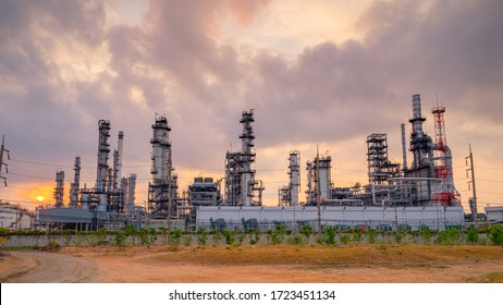 Oil refinery plant from industry zone, oil and gas petrochemical industrial, Refinery factory oil storage tank and pipeline steel at night, Ecosystem and healthy environment concepts.
