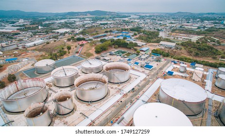 Oil refinery plant from industry zone, Aerial view oil and gas petrochemical industrial, Refinery factory oil storage tank and pipeline steel