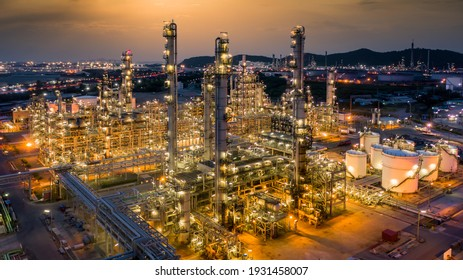 Oil refinery plant from industry zone, Aerial view oil and gas petrochemical industrial, Refinery factory oil storage tank and pipeline steel at night, Ecosystem and healthy environment. - Shutterstock ID 1931458007